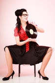 Pinup girl with vinyl record — Stock Photo