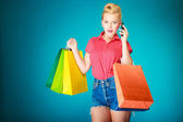 Pinup girl with shopping bags — Stock Photo