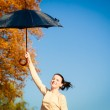 Girl with umbrella in park — Stock Photo #54711313