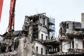 Building demolition by machinery — Foto Stock