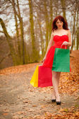 Woman with sale bags in park — Foto Stock