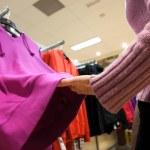 Woman choose blouse at shop — Stock Photo #54851531