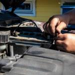 Auto mechanic checking accumulator — Stock Photo #54935515