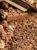 Different sorts chocolate and shavings. — Stock Photo