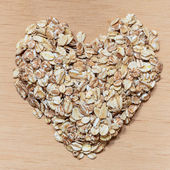 Oat flakes cereal heart shaped — Stock Photo