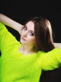 Beautiful woman in vivid color sweater — Stock Photo