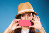 Woman taking self picture with smartphone — Stock Photo