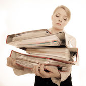Businesswoman holding stack of documents — Stockfoto