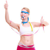 Woman with measure tapes showing thumb up — Stock Photo