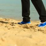 Woman senior walking on beach — Stock Photo #55330651