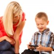Mother and son playing video game — Stock Photo #55330883
