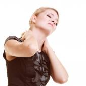 Businesswoman suffering from neck pain — Stock Photo