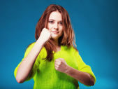 Teen girl clenching fists — Stock Photo
