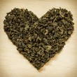 Green tea leaves heart shaped — Stock Photo #55542637