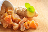 Root and candied ginger on table — Foto Stock