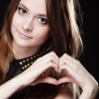 Girl doing heart shape symbol — Stock Photo #55928321