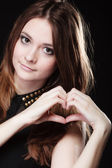 Girl doing heart shape symbol — Stock Photo