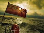 British maritime flag flown from yacht — Stockfoto