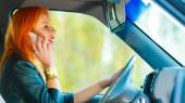 Girl talking on phone while driving car — Stok fotoğraf