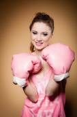 Female boxer wearing big gloves — Foto de Stock