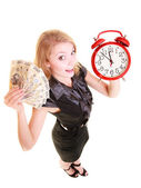 Woman holding money and alarm clock — Stock fotografie