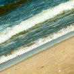Waves on shore of sandy beach — Stock Photo #56507515