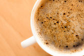 Cup of coffee with froth — Stock Photo