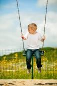 Boy having fun on swing — Stock Photo