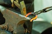 Hammering glowing steel — Stock Photo