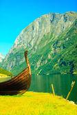 Old viking boat on seashore. — Stockfoto