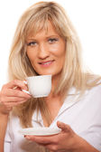 Mature woman drinking coffee — Stock Photo