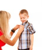 Mother and son buttoning on shirt — Stock Photo