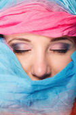 Woman hiden face with shawl — Stock Photo