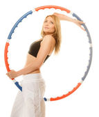 Girl doing exercise with hula hoop — Stock Photo