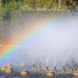 Splashing water of fountain with rainbow — Stock Photo #57122585