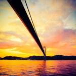 Sunset over suspension bridge in Bergen, Norway — Stock Photo #57558837