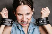 Arrest and jail. Criminal woman prisoner girl in handcuffs — Stock Photo