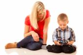 Mother and son playing video game — Stock Photo