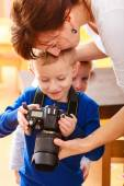Mother and children playing with camera — Foto de Stock