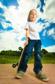 Boy  with his skateboard. — Stock Photo