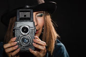 Retro woman with old camera. — Stock Photo