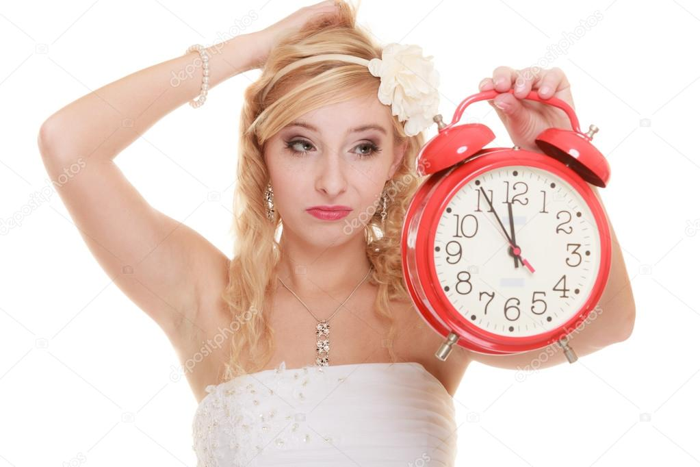 Bride with alarm clock. � Stock Photo � Voyagerix #58231473