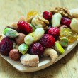 Varieties of dried fruits and nuts on wooden spoon. — Stock Photo #58753021
