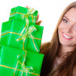 Girl with many green gift boxes isolated — Stock Photo #58753203