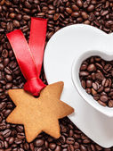 Star shaped christmas cookies and coffee beans — Stock Photo