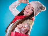 Winter woman with red paper shopping bag — Foto de Stock