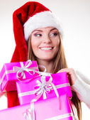 Woman in  santa helper hat holding pink gift boxes — 图库照片