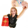 Woman with gift box and euro banknotesc smiling — Stock Photo #58839699