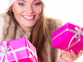 Girl with pink gift boxes posing — Stock Photo