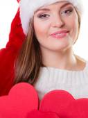 Woman in santa helper hat holding red boxes — Stock Photo